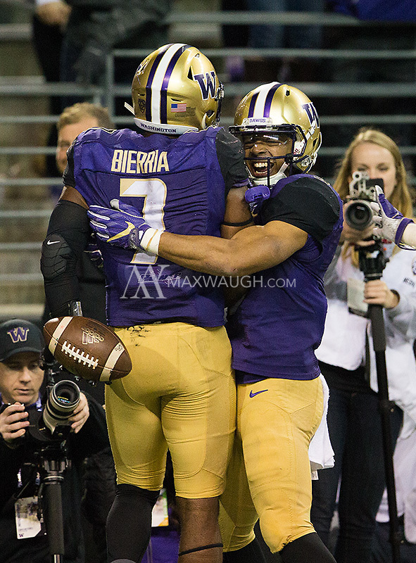 Myles Gaskin celebrates Bierria's return touchdown.