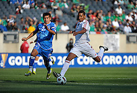 Cuba's Marcel Hernandez prepares to take a shot on goal while being pursued by El Salvandor's Luis Anaya.  El Salvador defeated Cuba 6-1 at the 2011 CONCACAF Gold Cup at Soldier Field in Chicago, IL on June 12, 2011.