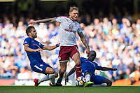 Burnley's Jeff Hendrick wins a free kick under pressure from Chelsea's Ngolo Kante and Cesc Fabregas<br /> <br /> Photographer Craig Mercer/CameraSport<br /> <br /> The Premier League - Chelsea v Burnley - Saturday August 12th 2017 - Stamford Bridge - London<br /> <br /> World Copyright &copy; 2017 CameraSport. All rights reserved. 43 Linden Ave. Countesthorpe. Leicester. England. LE8 5PG - Tel: +44 (0) 116 277 4147 - admin@camerasport.com - www.camerasport.com