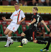 FUSSBALL   1. BUNDESLIGA  SAISON 2011/2012   5. Spieltag FC Augsburg - Bayer 04 Leverkusen           09.09.2011 Axel Bellinghausen (li, FC Augsburg) gegen Andre Schuerrle (re, Bayer 04 Leverkusen)
