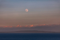 Moonrise over Moloka'i as seen from Hanauma Bay Ridge at dusk, East O'ahu.
