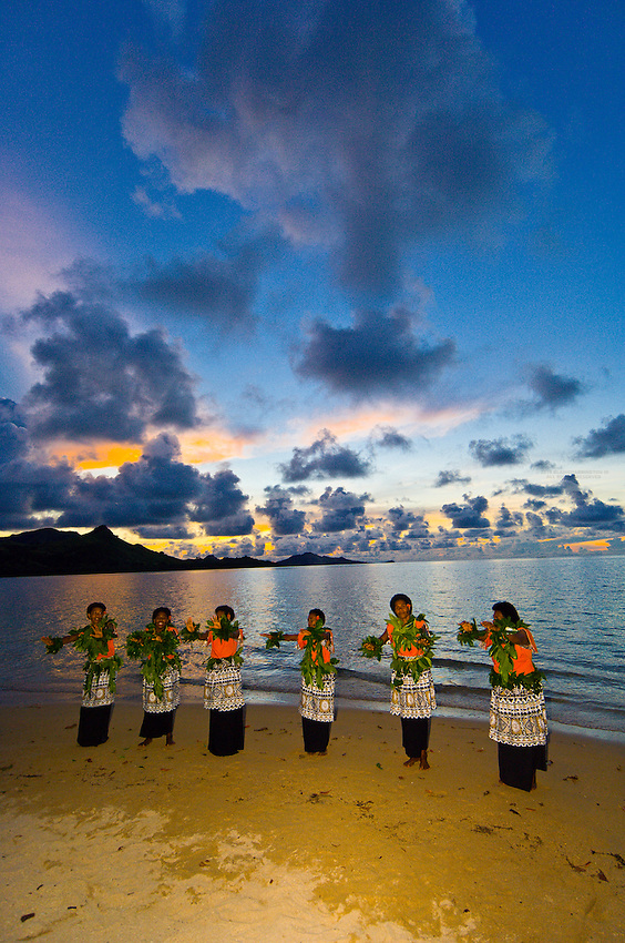 Fijian women performing on the beach at sunset, Nukubati Island Resort, Fiji Islands
