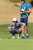 Tommy Fleetwood (ENG) lines up his putt on the 9th green during Thursday's Round 1 of the 2016 Portugal Masters held at the Oceanico Victoria Golf Course, Vilamoura, Algarve, Portugal. 19th October 2016.<br /> Picture: Eoin Clarke   Golffile<br /> <br /> <br /> All photos usage must carry mandatory copyright credit (© Golffile   Eoin Clarke)