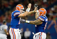 01 January 2010:  Tim Tebow of Florida celebrates with Mike Pouncey of Florida after Tebow threw 80 yards touchdown pass during the game against Cincinnati during Sugar Bowl at the SuperDome in New Orleans, Louisiana.  Florida defeated Cincinnati, 51-24.