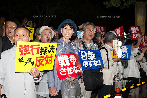 Demonstrators hold placards during a protest against proposed new security legislation in front of the National Parliament on September 16, 2015, Tokyo, Japan. Protestors faced off against the police during the demonstration outside the Japan Diet building, as SEALDs members and many people from different walks of life joined the now daily gathering against Prime Minister Shinzo Abe's push to secure final approval for new security bills that could allow Japanese troops to fight overseas for the first time in 70 years. (Photo by Rodrigo Reyes Marin/AFLO)