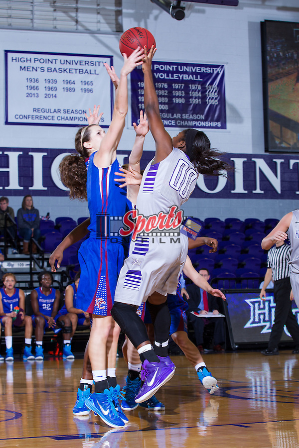Kat Harris (00) of the High Point Panthers has her shot blocked by Rebecca Walker (5) of the Presbyterian Blue Hose during first half action at Millis Athletic Center on December 6, 2014 in High Point, North Carolina.  The Panthers defeated the Blue Hose 54-49.   (Brian Westerholt/Sports On Film)
