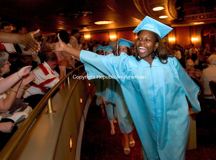 WATERBURY, CT- 15 JUNE 2007- 061507JT03-<br /> <br /> Waterbury Arts Magnet graduate Leanne Farley high-fives her father as she and her classmates walk to their seats for commencement ceremonies at the Palace Theater on Friday. <br /> Josalee Thrift Republican-American