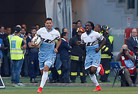 Calcio, Serie A: Lazio vs Roma. Roma, stadio Olimpico, 25 maggio 2015.<br /> Lazio's Filip Djordjevic, left, celebrates with teammate Luis Pedro Cavanda after scoring during the Italian Serie A football match between Lazio and Roma at Rome's Olympic stadium, 25 May 2015.<br /> UPDATE IMAGES PRESS/Riccardo De Luca