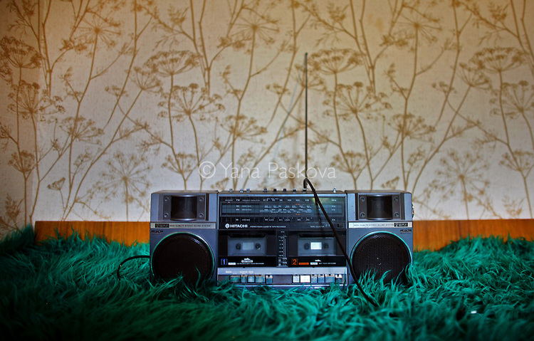A radio sits on a bedspread in Bregovo, Bulgaria, on August 2008.
