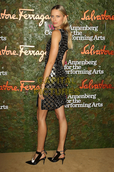 Karolina Kurkova<br /> Wallis Annenberg Center For The Performing Arts Inaugural Gala held at Wallis Annenberg Center For The Performing Arts,  Beverly Hills, California, USA, 17th October 2013.<br /> full length black gold dress zip sleeveless white feet shoes foot zips back over shoulder rear behind looking <br /> CAP/ADM/KB<br /> &copy;Kevan Brooks/AdMedia/Capital Pictures