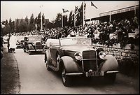 BNPS.co.uk (01202 558833)<br /> Pic: DukesAuctions/BNPS.<br /> <br /> Remarkable photos of Edward VIII touring a car factory during his controversial visit to Nazi Germany in 1937 have been unearthed.<br /> <br /> Huge crowds turned out to catch a glimpse of the former King, rumoured to be a strong supporter of the Nazi party and the fascist cause, who even walked through a guard of Nazi troops giving Hitler salutes.<br /> <br /> The Duke of Windsor, who had abdicated the previous year, was accompanied by high ranking Nazi party officials and even an SS officer whilst touring the Mercedes-Benz factory in Stuttgart.<br /> <br /> During the trip, the Duke had a private meeting with Hitler at his retreat in Berchtesgaden and was infamously photographed giving Nazi salutes.