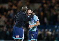 Adebayo Akinfenwa of Wycombe Wanderers with goalscorer Sam Wood of Wycombe Wanderers during the Sky Bet League 2 match between Wycombe Wanderers and Newport County at Adams Park, High Wycombe, England on 2 January 2017. Photo by Andy Rowland.