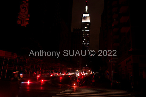 New York, New York.November 2, 2012..At Friday evening rush hour complete darkness envelopes Lexington Ave. south of 40th street in Manhattan nearly a week after Hurricane Sandy hit the north-eastern US coast. ..At 23rd street and Lex. police light the street with flares. ..Much of lower Manhattan was without electricity and the prolonged darkness spread fear. The light to the city turned on minutes later.