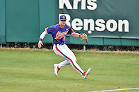 Clemson Tigers right fielder Seth Beer (28) tracks a ball during a game against the Maine Black Bears at Doug Kingsmore Stadium on February 20, 2016 in Clemson, South Carolina. The Tigers defeated the Black Bears 9-4. (Tony Farlow/Four Seam Images)