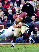 Washington Redskins quarterback Robert Griffin III (10) is sacked by Carolina Panthers defensive end Greg Hardy (76) in fourth quarter action at FedEx Field in Landover, Maryland on Sunday, November 4, 2012.  The Panthers won the game 21 - 13..Credit: Ron Sachs / CNP