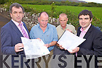 ALL MAPPED OUT: Examining the maps of the Special Protection Area for Castlemaine Harbour at an open evening in Keel last Thursday, l-r: Cllr Michael Cahill, Pat Foley (NPWS), Paschal Dower (NPWS), Cllr Brendan Griffin.
