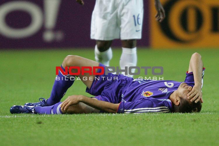 FIFA WM 2006 -  Gruppe F Vorrunde ( Group AF)<br /> Play   #43 (22-Jun) - Japan vs Brasilien 1:4<br /> <br /> Naohiro Takahara von Japan liegt verletzt am Boden und h&auml;lt sich das Knie.<br /> <br /> Foto &copy; nordphoto