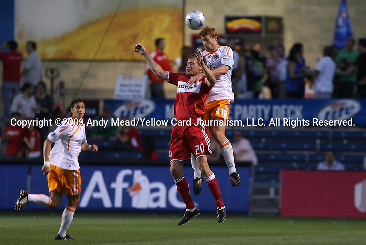 05 June 2009: Houston's Andrew Hainault (31) outjumps Chicago's Brian McBride (left) to a header. The Houston Dynamo defeated the Chicago Fire 1-0 at Toyota Park in Bridgeview, Illinois in a regular season Major League Soccer game.