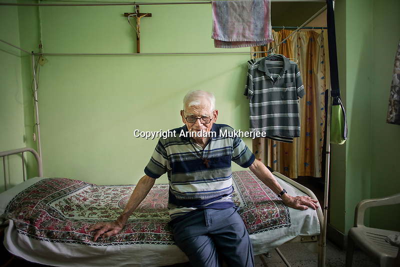 Father Laborde sits on his bed at his residence in Kolkata, West Bengal, India, Arindam Mukherjee/Agency Genesis