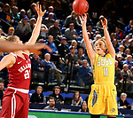 BROOKINGS, SD - DECEMBER 6: Madison Guebert #11 from South Dakota State spots up for a jumper over Gabbi Ortiz #21 from Oklahoma during their game Wednesday night at Frost Arena in Brookings. (Photo by Dave Eggen/Inertia)