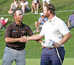 Cromwell, CT-22 JUNE 22 2018-062219MK14 Chez Reavie and Zach Sucher shake hands on the 18 green Saturday afternoon during the third round of the 2019 Travelers Championship at the TPC River Highlands in Cromwell. Michael Kabelka / Republican-American