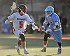 David Moyette #5 of Syosset, left, gets pressured by Kevin O'Keefe #1 of Oceanside during a Nassau County varsity boys lacrosse game at Syosset-Woodbury Community Park on Tuesday, Apr. 12, 2016. Syosset won by a score of 18-4.