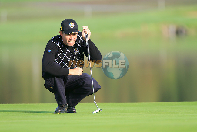 Padraig Harrington lines up his putt on the 13th green in the Day 2 session of the overnight Fourball Match 4 during Day 1 of the The 2010 Ryder Cup at the Celtic Manor, Newport, Wales, 29th September 2010..(Picture Eoin Clarke/www.golffile.ie)