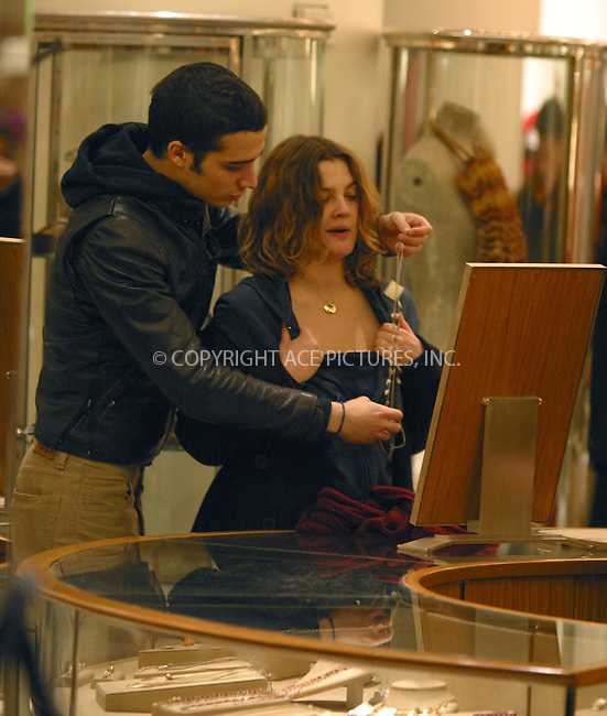 Actress Drew Barrymore and her musician boyfriend Fabrizio Moretti (drummer for The Strokes) did a very last minute Christmas shopping at Barney's New York. They arrived at about 5:30PM on a last shopping day before Christmas just before store-closing and stopped in the jewelry section. Drew kept yawning until Fabrizio found her a necklace she liked, and Drew got busy trying the necklace on with help of her boyfriend and a sales person. New York, December 24, 2002.  Please byline: Alecsey Boldeskul/NY Photo Press.   ..*PAY-PER-USE*      ....NY Photo Press:  ..phone (646) 267-6913;   ..e-mail: info@nyphotopress.com
