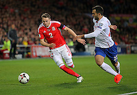 (L-R) Chris Gunter of Wales chased by Ivan Obradivic of Serbia during the 2018 FIFA World Cup Qualifier between Wales and Serbia at the Cardiff City Stadium, Wales, UK. Saturday 12 November 2016