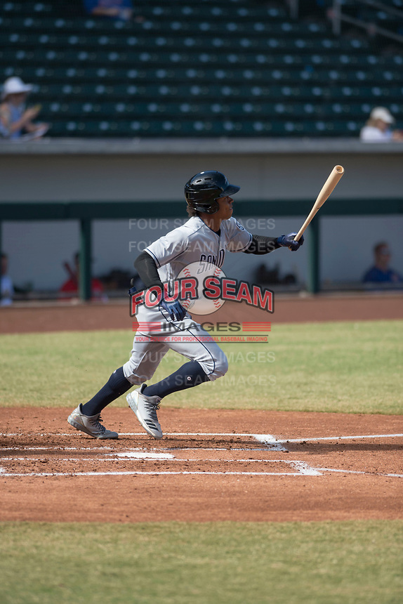 Peoria Javelinas left fielder Buddy Reed (85), of the San Diego Padres organization, starts down the first base line during an Arizona Fall League game against the Mesa Solar Sox at Sloan Park on October 24, 2018 in Mesa, Arizona. Mesa defeated Peoria 4-3. (Zachary Lucy/Four Seam Images)