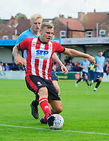 Lincoln City's Harry Anderson vies for possession with Gainsborough Trinity's Nathan Stainfield<br /> <br /> Photographer Chris Vaughan/CameraSport<br /> <br /> Football Pre-Season Friendly (Community Festival of Lincolnshire) - Gainsborough Trinity v Lincoln City - Saturday 6th July 2019 - The Martin & Co Arena - Gainsborough<br /> <br /> World Copyright © 2018 CameraSport. All rights reserved. 43 Linden Ave. Countesthorpe. Leicester. England. LE8 5PG - Tel: +44 (0) 116 277 4147 - admin@camerasport.com - www.camerasport.com