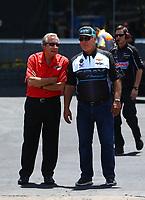Jun 18, 2017; Bristol, TN, USA; NHRA team owner Don Schumacher (left) talks with Johnny Gray during the Thunder Valley Nationals at Bristol Dragway. Mandatory Credit: Mark J. Rebilas-USA TODAY Sports