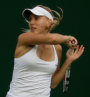Elena Vesnina (RUS) against Yanina Wickmayer (BEL) in the first round of the Ladies Singles. Vesnina beat Wickmayer 6-1 6-1..Tennis - Wimbledon - Day 9 - Wed 1st July 2009 - All England Lawn Tennis Club  - Wimbledon - London - United Kingdom..Frey Images, Barry House, 20-22 Worple Road, London, SW19 4DH.Tel - +44 20 8947 0100.Cell - +44 7843 383 012