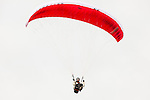 One adult male paraglider flies above Steptoe Butte State Park in Eastern Washington State.