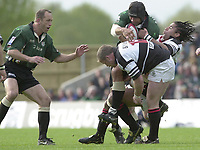 Sport - Rugby 27/04/2002 Parker Pen Shield - Semi-Final.London Irish vs Pontypridd - Kassam Stadium - Oxford.Exiles Chris Sheasby is tackled by Richard Parks and Jon Bryant .[Mandatory Credit, Peter Spurier/ Intersport Images].