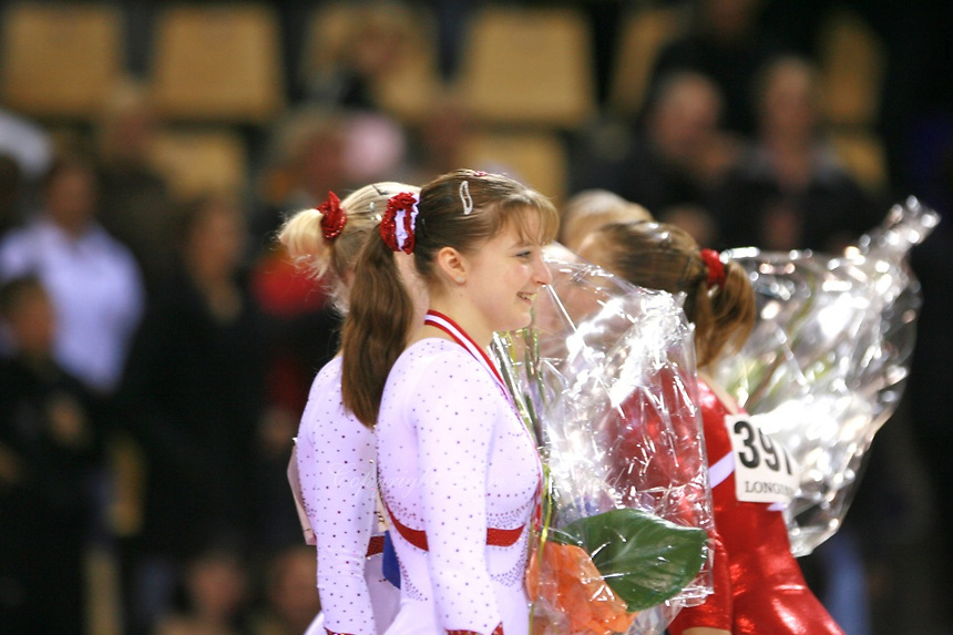 Oct 18, 2006; Aarhus, Denmark; Portrait is of .Anna Pavlova of Russia (and other team members) during women's gymnastics team final medals ceremony at 2006 World Championships Artistic Gymnastics. Photo by Tom Theobald