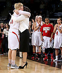SIOUX FALLS, SD - MARCH 10: Nicole Seekamp #35 from the University of South Dakota gets a hug from head coach Amy Williams after Seekamp won the tournaments Most Valuable Player in a loosing effort to the South Dakota State University Jackrabbits 72-57 in the Summit League Championship Tournament game Tuesday at the Denny Sanford Premier Center in Sioux Falls, SD. (Photo by Dave Eggen/Inertia)