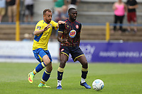 Emmanuel Sonupe of Stevenage lays the ball off under pressure from Scott Shulton of St Albans during St Albans City vs Stevenage, Friendly Match Football at Clarence Park on 13th July 2019
