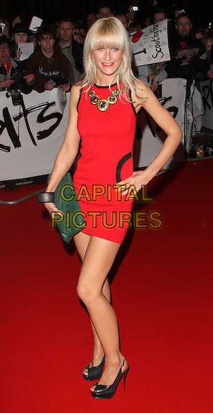 KATHERINE KELLY.Arrivals - 2009 Brit Awards, Earls Court, London, England. .February 18th 2009. .brits full length red dress black slingbacks shoes pocket trim sleeveless hand on hip green clutch bag.CAP/ROS.©Steve Ross/Capital Pictures.