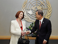UN Secretary General Ban-ki Moon hands Australian Prime Minister Julia Gillard her handbag after she almost forgot it at UN Headquarters in New York during her visit to the United States. pic by Trevor Collens.