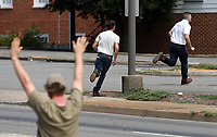 Crowd members chase away suspect White Nationalist from the downtown area after Unite the Right rally organizer Jason Kessler's press conference was disrupted by protestors Sun., August 13, 2017 outside City Hall in Charlottesville, Va. The previous day, a woman was killed and several others injured after the Unite the Right rally. Photo/Andrew Shurtleff
