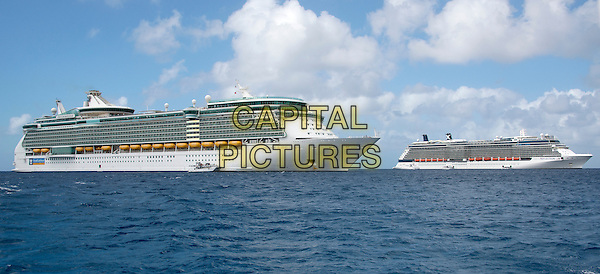 Two large cruise ships, from left to right, the Royal Caribbean Freedom of the Seas, which carries 4,515 passengers and 1,360 crew, and the Celebrity Reflection, which carries 3,609 passengers and 1271 crew, in the harbor of George Town, Grand Cayman in the Cayman Islands on Tuesday, December 20, 2016.  The smaller boats are tenders to ferry passengers back and forth to the island. Both Royal Caribbean and Celebrity are brands of Royal Caribbean International.<br /> CAP/MPI/RS<br /> &copy;RS/MPI/Capital Pictures