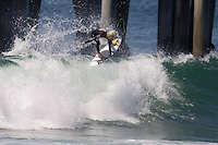 American Nat Young boosts an air during round of 96 of the 2010 US Open of Surfing in Huntington Beach, California on August 4, 2010.