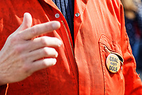 Pictured: Cole not dole pin worn by one of The Man Engine crew at the Waterfront Museum in Swansea, Wales, UK. Thursday 12 April 2018<br /> Re: The largest mechanical puppet in Britain starts its tour across south Wales.<br /> Man Engine, a mechanical miner which measures 36ft (11m) tall, will appear at the Waterfront Museum in Swansea, Wales, animated by a dozen handlers.<br /> The giant is visiting areas linked to the nation's industrial past.