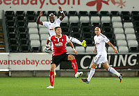 Pictured: Dwight Tiendalli of Swansea battling for a header against Alex Revell. Tuesday 26 August 2014<br /> Re: Capital One Cup, Swansea City FC v Rotherham at the Liberty Stadium, south Wales