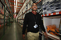 Toki Lewis, who works with the Seau Foundation, walks through the warehouse of his San Marcos, California workplace in 2012.  photo for the North County Times