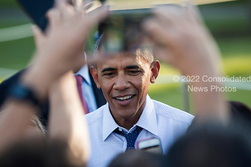 United States President Barack Obama greets attendees to a picnic for members of Congress on the South Lawn of the White House in Washington, DC, USA, 14 June 2016. Democratic presidential candidate Bernie Sanders was reported to be in attendance.<br /> Credit: Jim LoScalzo / Pool via CNP