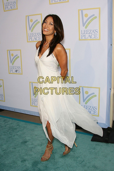 CARRIE ANN INABA.Opening of Assistance League Leeza's Place Care Center in Hollywood, Los Angeles, California, USA,.21 April 2006..full length white dress carrie-ann carrie-anne anne.Ref: ADM/ZL.www.capitalpictures.com.sales@capitalpictures.com.©Zach Lipp/AdMedia/Capital Pictures.