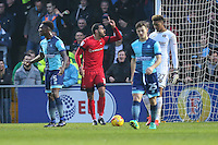 Paul McCallum of Leyton Orient (2nd left) points to the Assiistant Referee as his attempt is ruled out for off-side during the Sky Bet League 2 match between Wycombe Wanderers and Leyton Orient at Adams Park, High Wycombe, England on 17 December 2016. Photo by David Horn / PRiME Media Images.