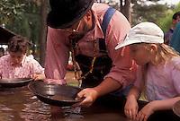 AJ3391, gold panning, Stone Mountain, Atlanta, Georgia's Stone Mountain Park, Georgia, Man shows children how to pan for gold during the Antebellum Jubilee at Stone Mountain Park in Atlanta in the state of Georgia.
